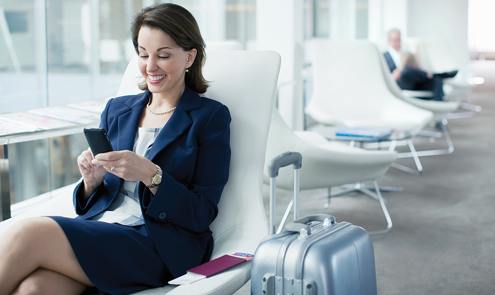 business travel insurance. Woman waiting in the airport
