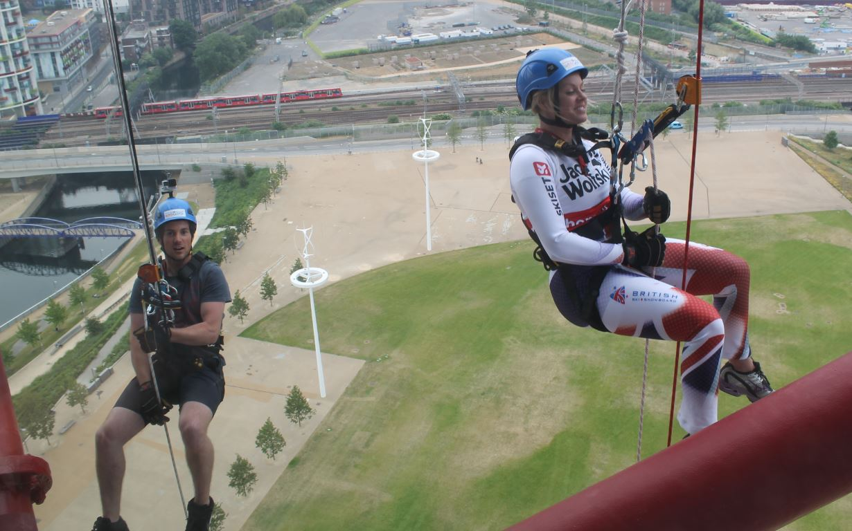 Chemmy and Dougie abseiling