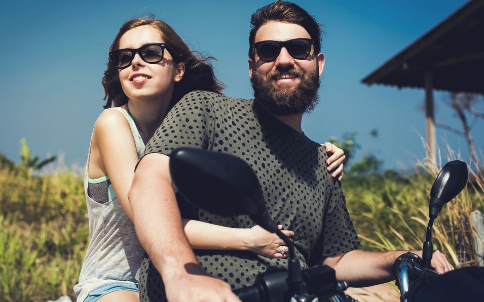 Man and woman on bike