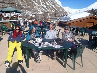Chalet workers drinking on mountain