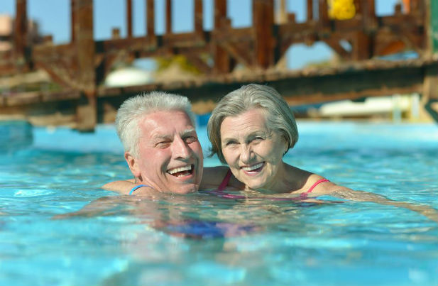 Couple in the pool swimming