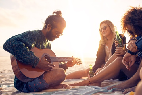 Playing guitar on the beach