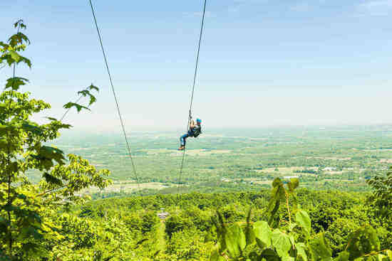 adventurous man zip lining
