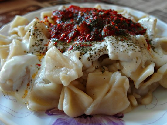 Manti is a steamed or boiled dumpling filled with lamb, ground beef or a vegetarian option. A staple food of Turkey