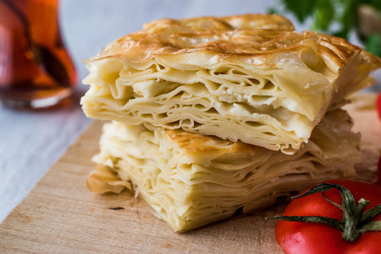 Su Böreği is a layered pastry dish with a cheese and parsley filling