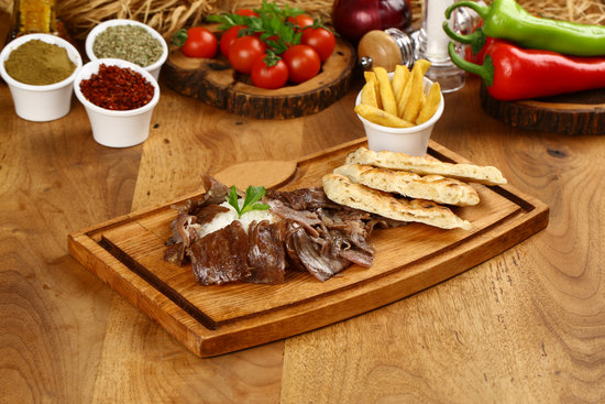 Turkish kebab served with pita on the side and chips
