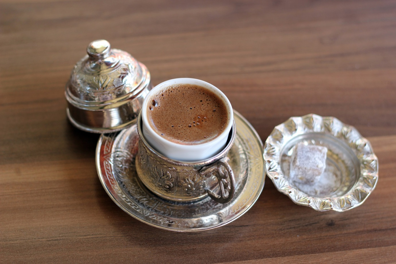 Turkish coffee is made from finely ground beans, and served in copper or brass with a Turkish delight