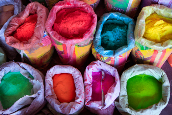 Bags of colourful gulal powder for Holi in India