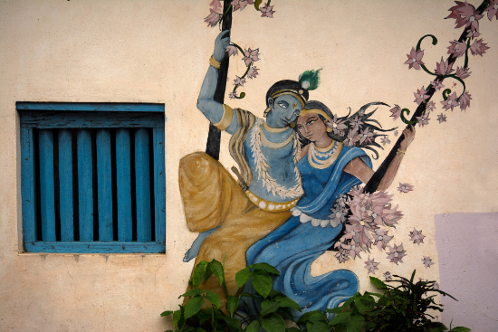 Beautiful Indian graffiti street art depicting Krishna and Radha in love