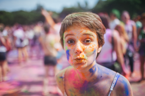 Woman celebrating Holi in Melbourne smudged with colourful powder