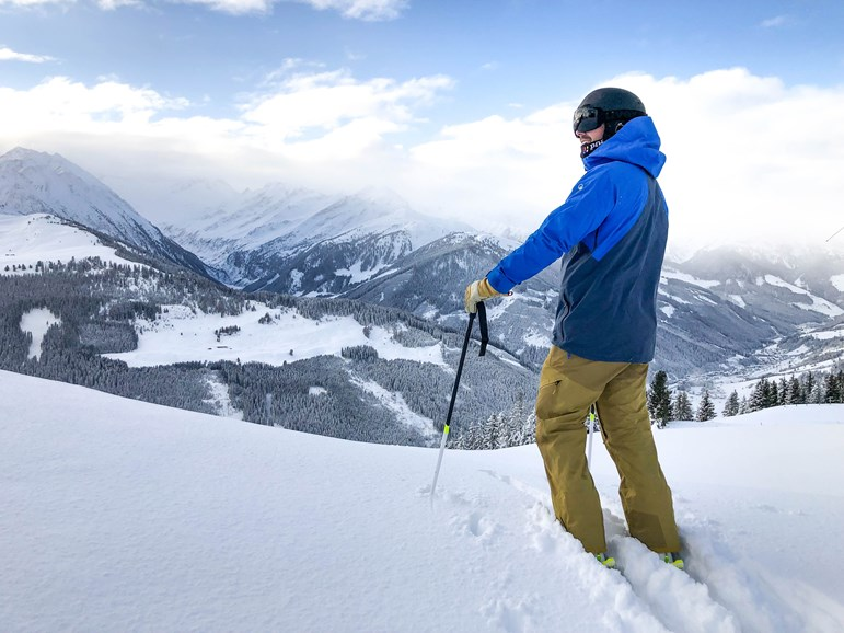 Skier standing in the snow on a mountain