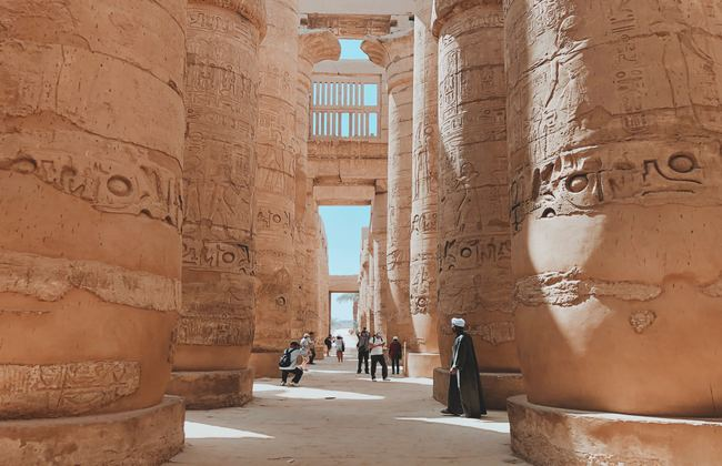 People walking around Karnak Temple in Egypt
